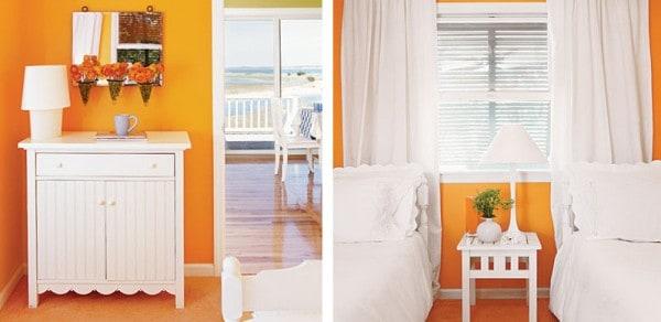 Muebles blancos con paredes naranja